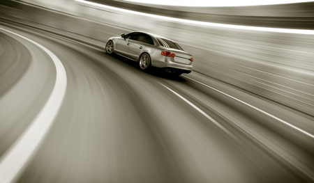 3d rendering of a brandless generic car of my own design in a tunnel with heavy motion blur Stock Photo - 12904999