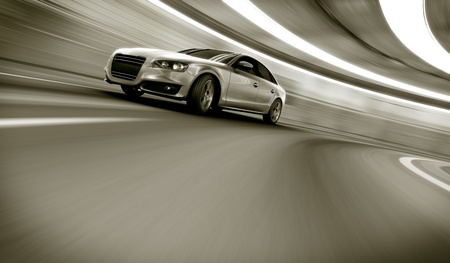 3d rendering of a brandless generic car of my own design in a tunnel with heavy motion blur photo