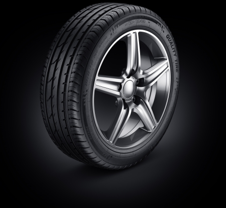 3d rendering of a single car tire on a black background photo