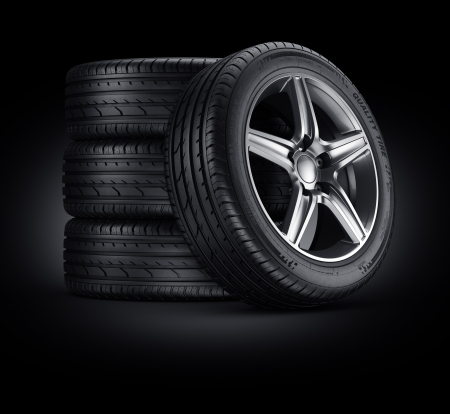 3d rendering of a 4 car tires on a black background
