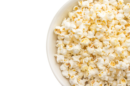 Bowl of popcorn isolated on white background  Top view Stock Photo