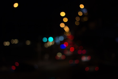 Defocused street lights bokeh background of the night city Stock Photo