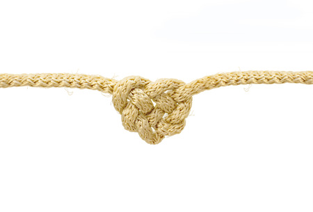 Heart shaped knot on a rope isolated on white background with clipping path