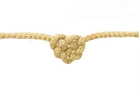 gefesselt: Heart shaped Knoten auf einem Seil isoliert auf weißem Hintergrund mit Clipping-Pfad Lizenzfreie Bilder