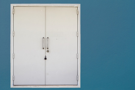 blue wall: Closed door on blue wall background