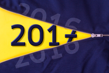 Open zipper on yellow background with 2017 text. Stock Photo