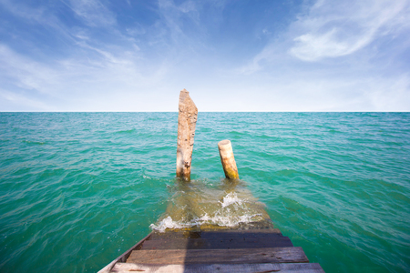 Old wooden pier with seascape and blue sky Stock Photo