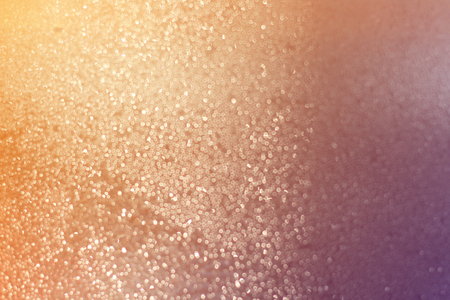 Abstract of bright and sparkling bokeh background-blurred lighting from glitter texture.