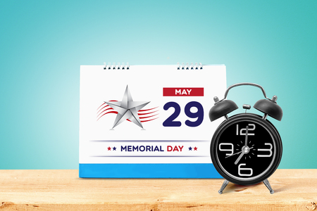 Happy Memorial Day 2017 with calendar and alarm clock on wooden table isolated on blue background