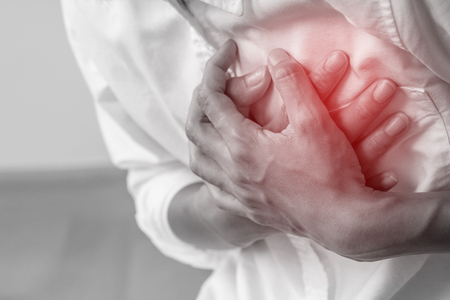 Man clutching his chest, acute pain possible heart attack.Heart attack symptom-Health