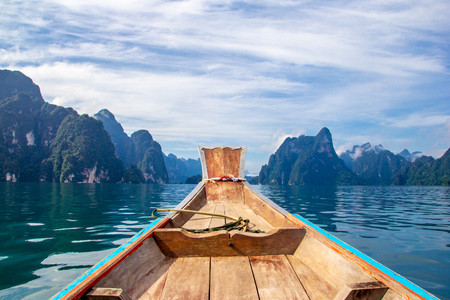 Wooden longtail boat sailing Stock Photo