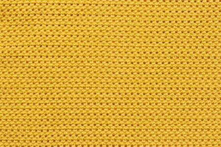 Close up detail of yellow fabric texture background.