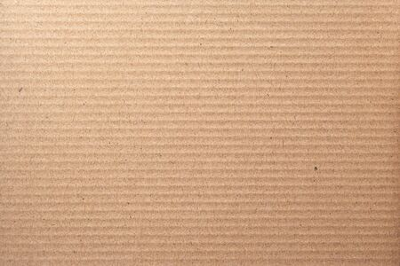 Brown corrugated cardboard sheet texture with horizontal stripes can be used for background. Banco de Imagens