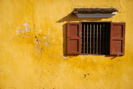 opened-window on yellow wall photo