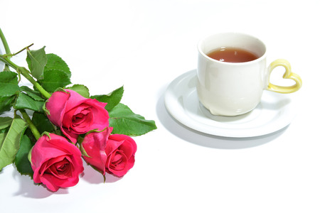 Tea cup of love and three pink roses photo