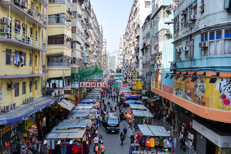 fa: HONG KONG CHINA  JANUARY 23 2015: Many street vendors selling products on Fa Yuen Street between the buildings. People walk in the busy district of Mong Kok Kowloon Hong Kong. Editorial