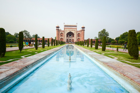 monument in india: AGRA INDIA  JULY 13 2014 : Front gate to Taj Mahal famous historical monument in Agra India.