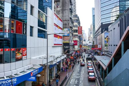 HONG KONG CHINA  JANUARY 23 2015: Mong Kok District in Kowloon Peninsula Hong Kong. Mong Kok is the most busy and overcrowded district in Hong Kong.