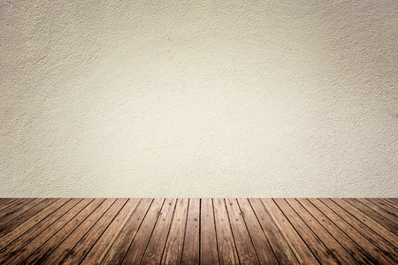 Empty room of beige cement plaster wall and brown wood floor
