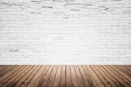 Old interior room with broken white brick wall and grunge wood floor texture