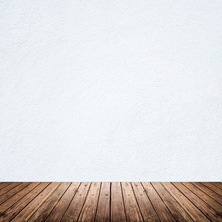 white wood floor: Empty room of white cement plaster wall and brown wood floor