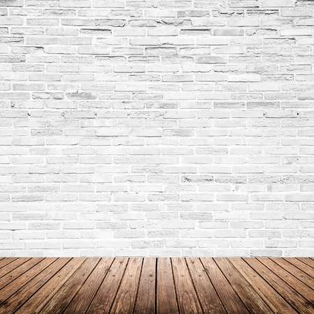 building backgrounds: Old interior room with broken white brick wall and grunge wood floor texture