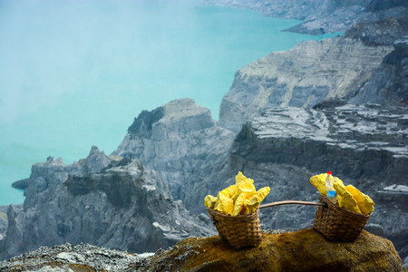 Baskets with sulphur sulfur at Kawah Ijen volcano crater East Java Indonesia