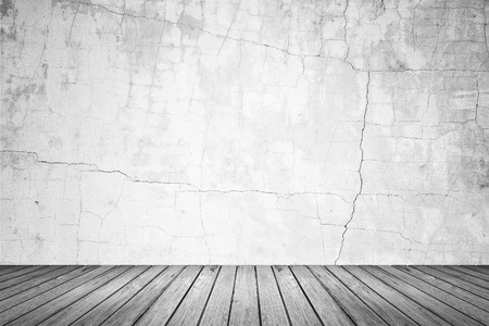 cracked wall: Empty room of old grunge cracked concrete wall and gray wood floor Stock Photo
