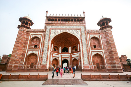 monument in india: AGRA, INDIA - JULY 13, 2014 : Front gate to Taj Mahal, famous historical monument in Agra, India.