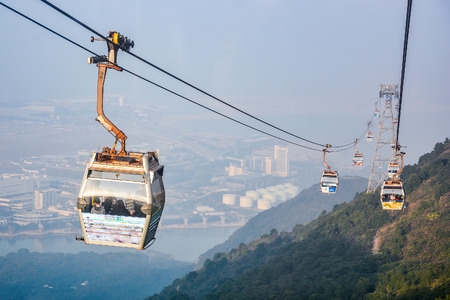 lantau: HONG KONG, CHINA - JANUARY 25 : Cable cars of Ngong Ping on Lantau island of Hong Kong on January 25, 2015. Lantau is the largest island in Hong Kong, located at the mouth of the Pearl River.
