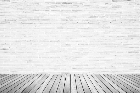 white wood floor: Old interior room with broken white brick wall and grunge wood floor texture in gray tone