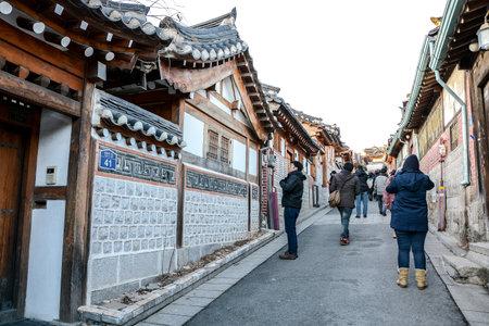 korean style house: SEOUL, SOUTH KOREA - OCTOBER 2, 2014 : Tourists walk in the beautiful scenery around Bukchon Hanok Village,Traditional Korean style architecture in Seoul, South Korea.