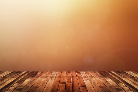ビンテージ: 暖かいトーン色赤、オレンジと黄色の抽象的な背景をぼかした写真を暗い茶色の木の床。背景や web デザインのための使用
