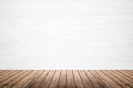 white wood floor: Empty room of white wood texture wall and brown wooden floor. use for backdrop or background