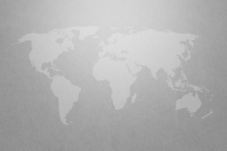 world map graphic on gray paper texture background with light on top Stockfoto