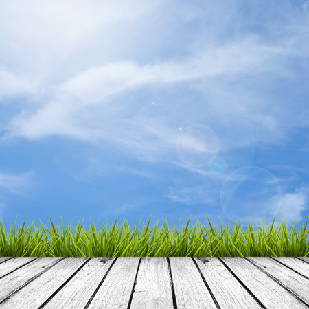 blue texture: Gray grey wooden floor texture of terrace with fresh green grass under the blue sky, clouds and sunlight of summer, use for background