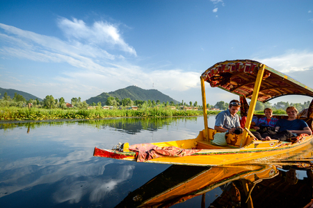 SRINAGAR, INDIA - JULY 11, 2014 : Lifestyle in Dal lake, people who come here use Shikara, a small boat for tourism in the lake of Srinagar, Jammu and Kashmir state, India