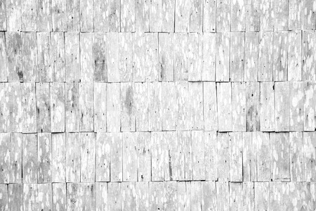 shingle: closeup detail of abstract white grunge wood shingle wall pattern background