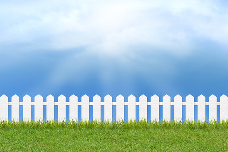 fresh green grass and white wooden fence under blue sky ,clouds and sunlight of summer background Zdjęcie Seryjne