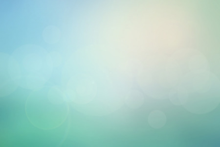 Abstract pastel sky blurred background in blue-turquoise tone with bright sunlight and flare, use for backdrop or web design in natural summer concept
