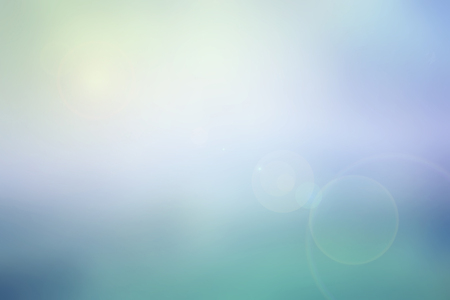 Abstract pastel sky blurred background in colorful tone blue, violet, turquoise and yellow with bright sunlight and flare, use for backdrop or web design in summer concept Stockfoto