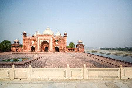 west river: AGRA, INDIA - JULY 13, 2014 : Mosque on the West side of Taj Mahal near the Yamuna river - view from Taj Mahal, famous place of India.