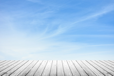 wood floor: white grunge wooden floor and blur sky with cirrus clouds Stock Photo