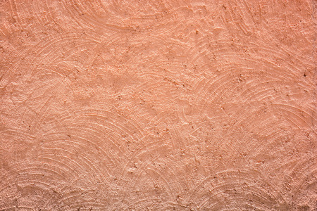 cement wall: closeup of Red-brown rough cement plaster wall texture background Stock Photo