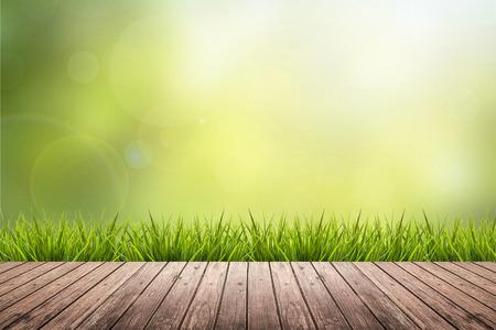 Frisches Frühlingsgras mit grünen Natur unscharfen Hintergrund und Holzboden Standard-Bild - 44974238