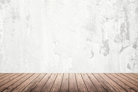 vintage design: Empty room of old grunge cracked white concrete wall and dark brown wooden floor with light on top