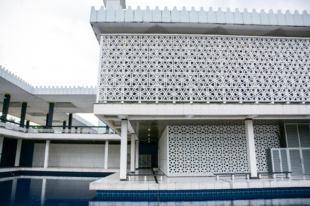 malaysia culture: KUALA LUMPUR, MALAYSIA - MAY 24, 2014 : The National Mosque of Malaysia is a popular tourist attraction site in the city of Kuala Lumpur. Editorial