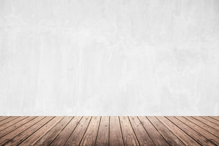empty surface: Empty room of old grunge white natural concrete wall and dark brown wooden floor, use for background, backdrop or design element