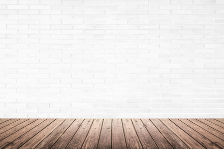 brick floor: Old interior room with white brick wall texture and brown grunge wood floor pattern, use for background, backdrop or design element Stock Photo