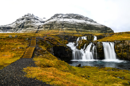 natural landmark: Beautiful waterfall landscape near Kirkjufell mountain in the Snaefellsnes Peninsula, natural landmark of West Iceland